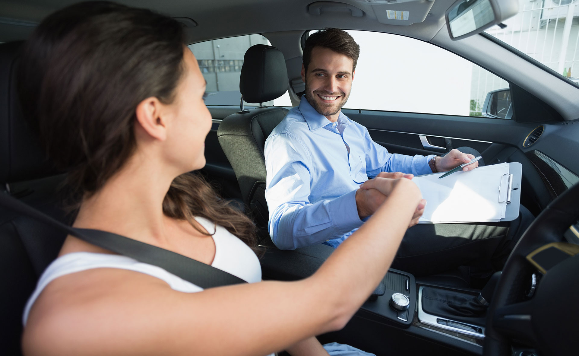 Road Testing woman shaking hand with happy man